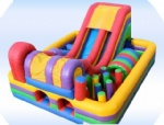 Inflatable obstacle slide